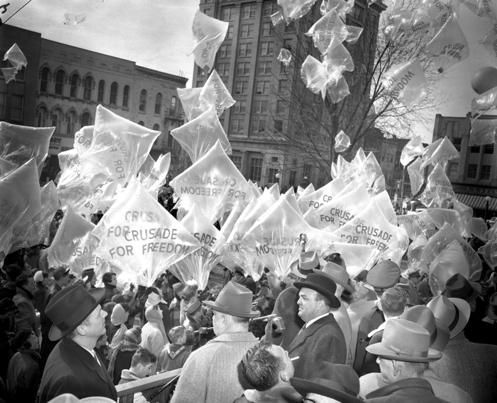 Cruise for Freedom parade through downtown, people carrying large helium balloons, Feb. 12, 1954.  The State Journal-Register/archive