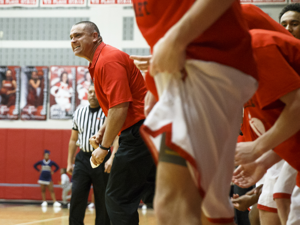 Glenwood head basketball coach Todd Blakeman is fired up after the Titans get a charging foul against Southeast in the second quarter at Glenwood High School, Friday, Feb. 19, 2016, in Chatham, Ill. Justin L. Fowler/The State Journal-Register