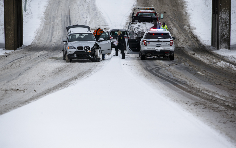 "Stevenson Drive is shut down as Springfield Police work the scene of a multi-vehicle accident after a snowstorm dumped between 2-5"" of snow across the area, Sunday, Feb. 14, 2016, in Springfield, Ill. Justin L. Fowler/The State Journal-Register"