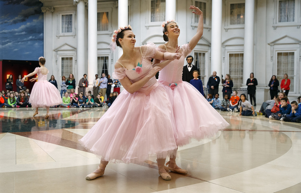 Tiffany Riech, left, elbows  during the Leap into Lincoln with the Springfield Ballet Company presentation of Pas de Quatre at the Abraham Lincoln Presidential Museum Tuesday, Feb. 16, 2016.  The Pas de Quatre debuted in London in 1845 by four of the most highly regarded ballerinas of the time. Tuesday's performance poked light-hearted fun at the reported feuding between the highly competitive dancers from the original performance. Ted Schurter/The State Journal-Register