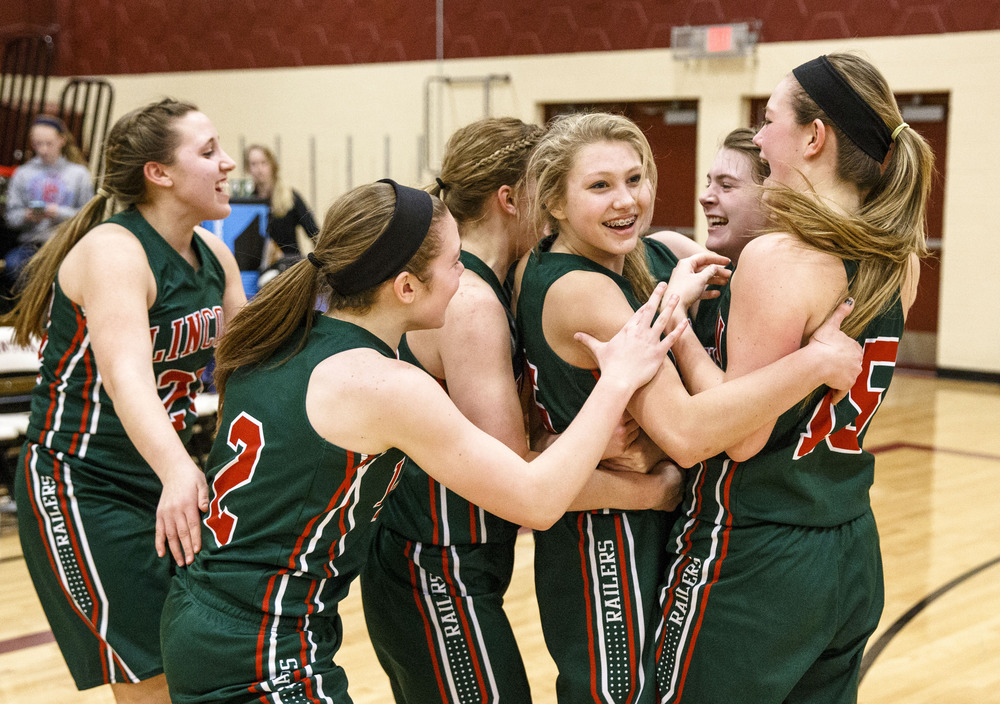 Lincoln's Kaelyn Froebe (5), center, celebrates with her teammates after the Railsplittters defeated Rochester 50-46 in the Class 3A Clinton Sectional semifinals at Clinton High School, Monday, Feb. 22, 2016, in Clinton, Ill. Justin L. Fowler/The State Journal-Register