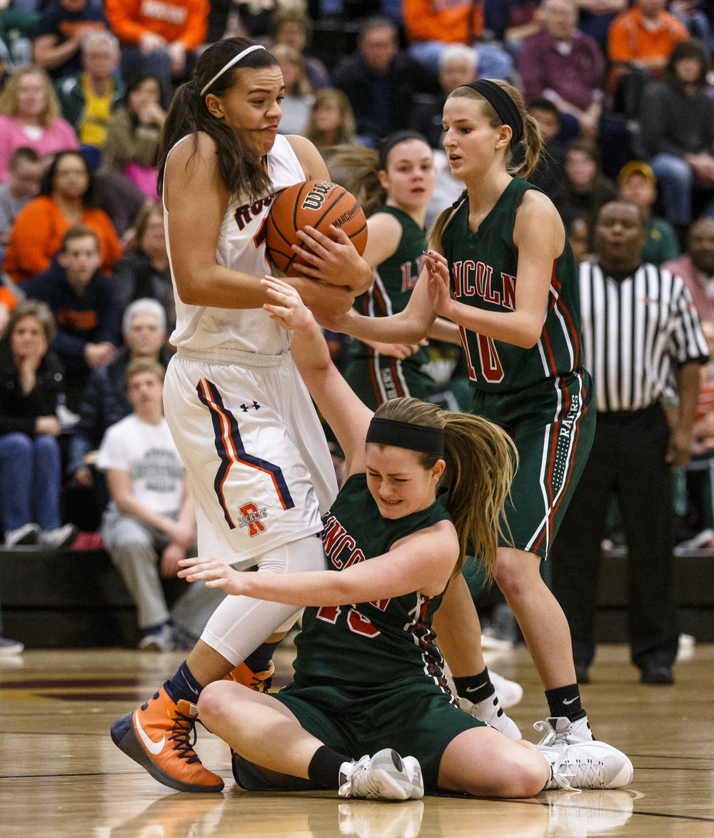 Rochester's Lyric Boone (14) and Lincoln's Grace Bossingham (15) battle for possession of the ball in the first quarter during the Class 3A Clinton Sectional semifinals at Clinton High School, Monday, Feb. 22, 2016, in Clinton, Ill. Justin L. Fowler/The State Journal-Register