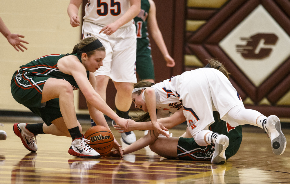 Rochester's Aubrey Magro (20) drives for a loose ball against Lincoln's Kennedy Lolling (14) in the second quarter during the Class 3A Clinton Sectional semifinals at Clinton High School, Monday, Feb. 22, 2016, in Clinton, Ill. Justin L. Fowler/The State Journal-Register