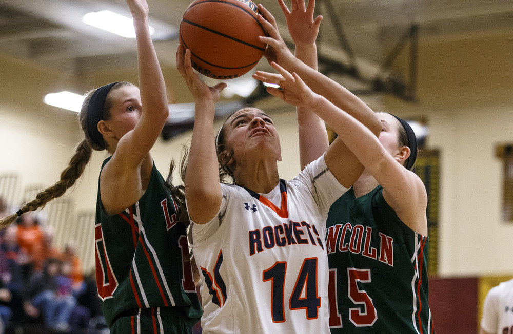 Rochester's Lyric Boone (14) battles underneath the basket against Lincoln's Grace Bossingham (15) in the third quarter during the Class 3A Clinton Sectional semifinals at Clinton High School, Monday, Feb. 22, 2016, in Clinton, Ill. Justin L. Fowler/The State Journal-Register
