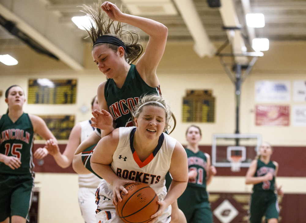 Lincoln's Morgan Lolling (2) fouls Rochester's Kylie Clemens (11) underneath the basket in the third quarter during the Class 3A Clinton Sectional semifinals at Clinton High School, Monday, Feb. 22, 2016, in Clinton, Ill. Justin L. Fowler/The State Journal-Register