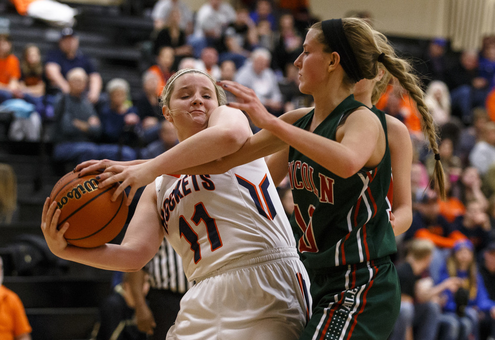 Rochester's Kylie Clemens (11) battles for a rebound against Lincoln's Hailie Williams (10) in the third quarter during the Class 3A Clinton Sectional semifinals at Clinton High School, Monday, Feb. 22, 2016, in Clinton, Ill. Justin L. Fowler/The State Journal-Register