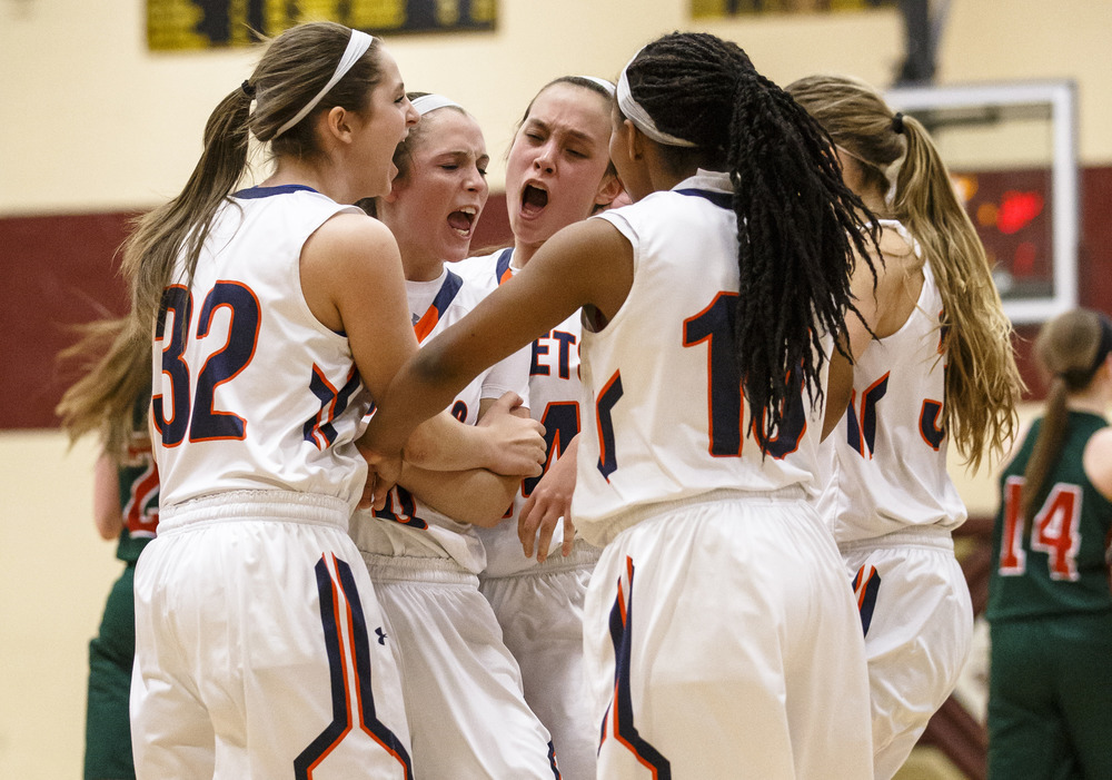 Rochester's Aubrey Magro (20) is mobbed by her teammates after hitting a second 3-pointer to make it 47-46 Lincoln in the fourth quarter during the Class 3A Clinton Sectional semifinals at Clinton High School, Monday, Feb. 22, 2016, in Clinton, Ill. Justin L. Fowler/The State Journal-Register