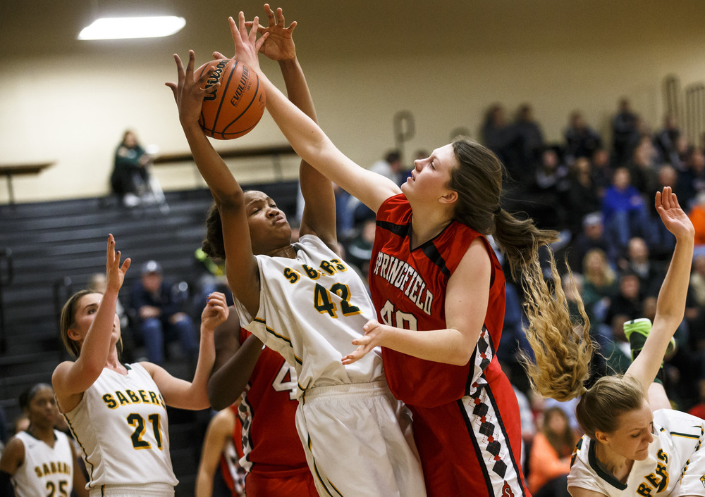 Springfield's Abby Ratsch (40) goes for a rebound against Champaign St. Thomas More's Nakaya Hughes (42) in the second quarter during the Class 3A Clinton Sectional semifinals at Clinton High School, Monday, Feb. 22, 2016, in Clinton, Ill. Justin L. Fowler/The State Journal-Register
