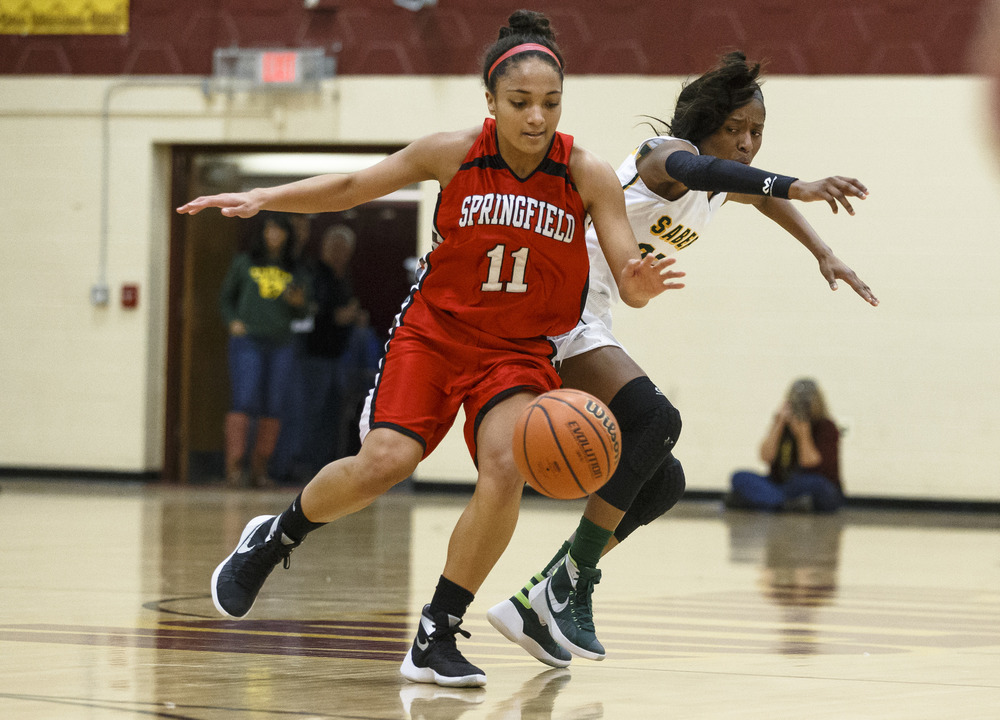 Springfield's Kyra Webster (11) steals the ball away from Champaign St. Thomas More's Airiana Smith (25) in the second quarter during the Class 3A Clinton Sectional semifinals at Clinton High School, Monday, Feb. 22, 2016, in Clinton, Ill. Justin L. Fowler/The State Journal-Register