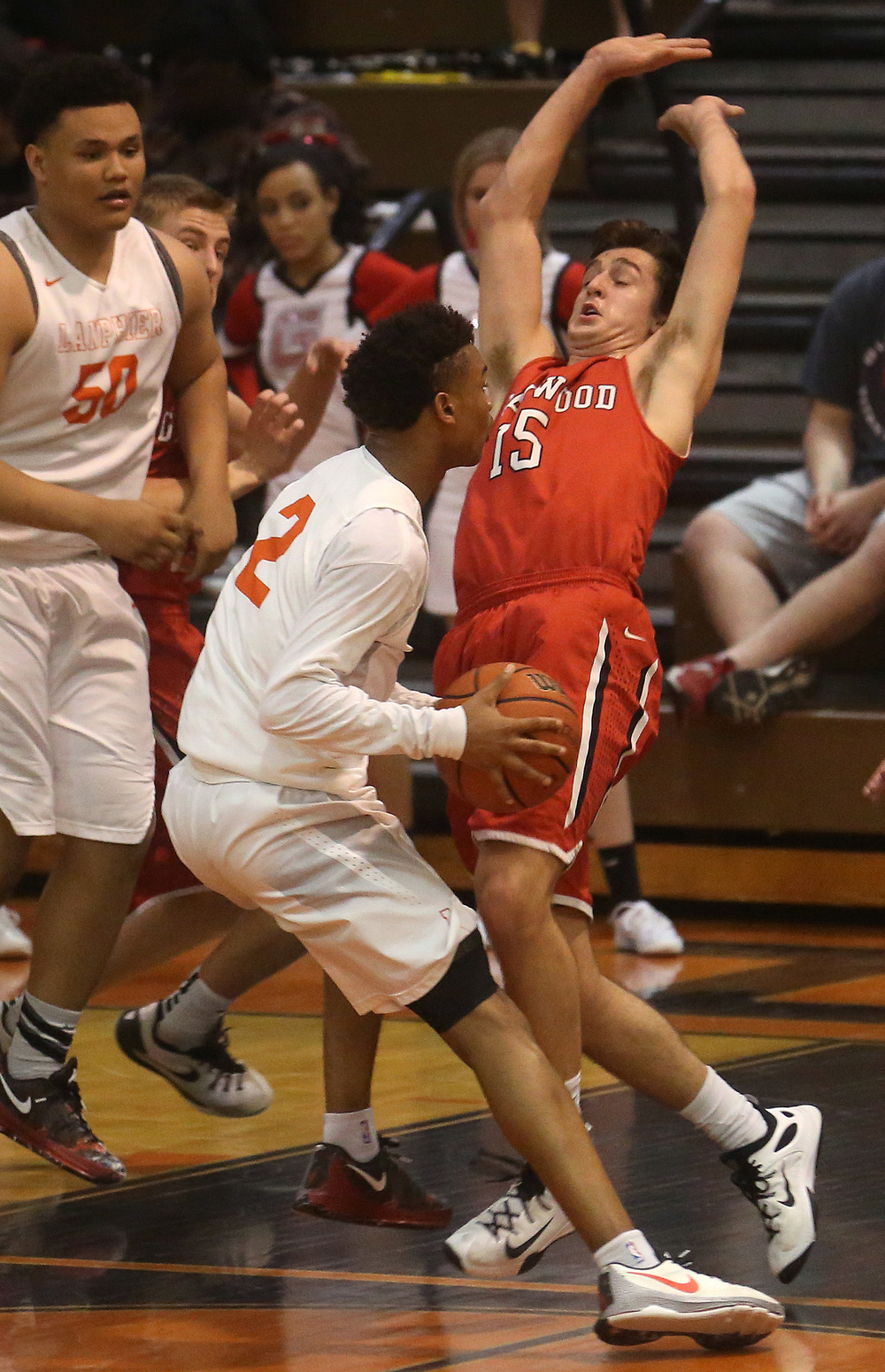 Glenwood's Joel Alexander plays defense while Lanphier's Cardell McGee tries to get around him.  David Spencer/The State Journal Register