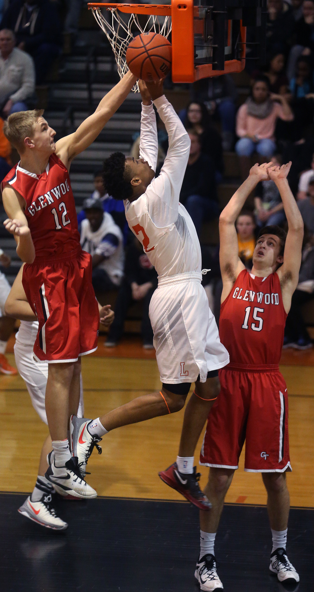 Lanphier's Cardell McGee has his shot blocked by Glenwood's Karson Aherin while Glenwood player Joel Alexander also defends at right. David Spencer/The State Journal Register