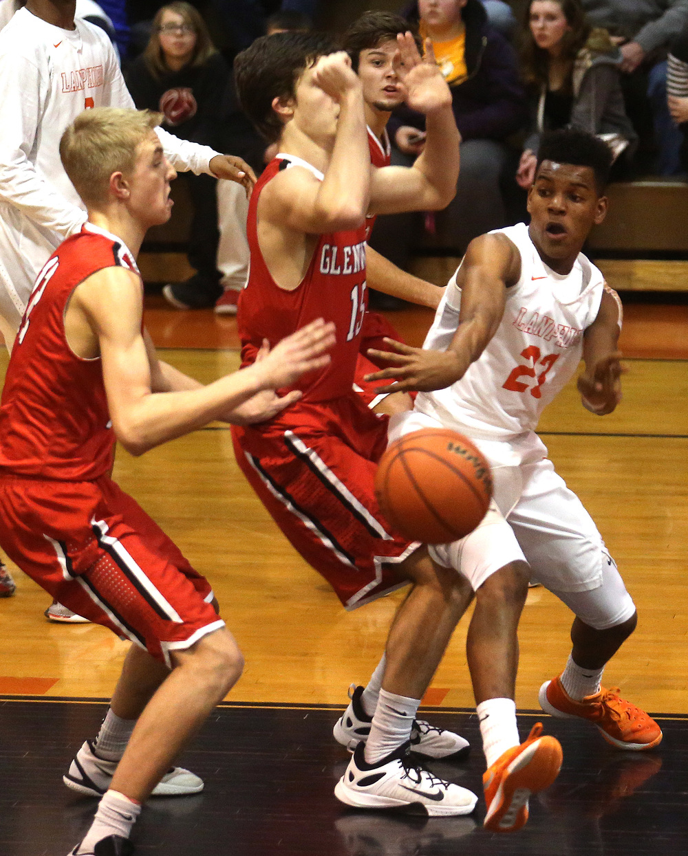 Lanphier's Aundrae Williams passes the ball past Glenwood defenders Karson Aherin at left and Joel Alexander. David Spencer/The State Journal Register