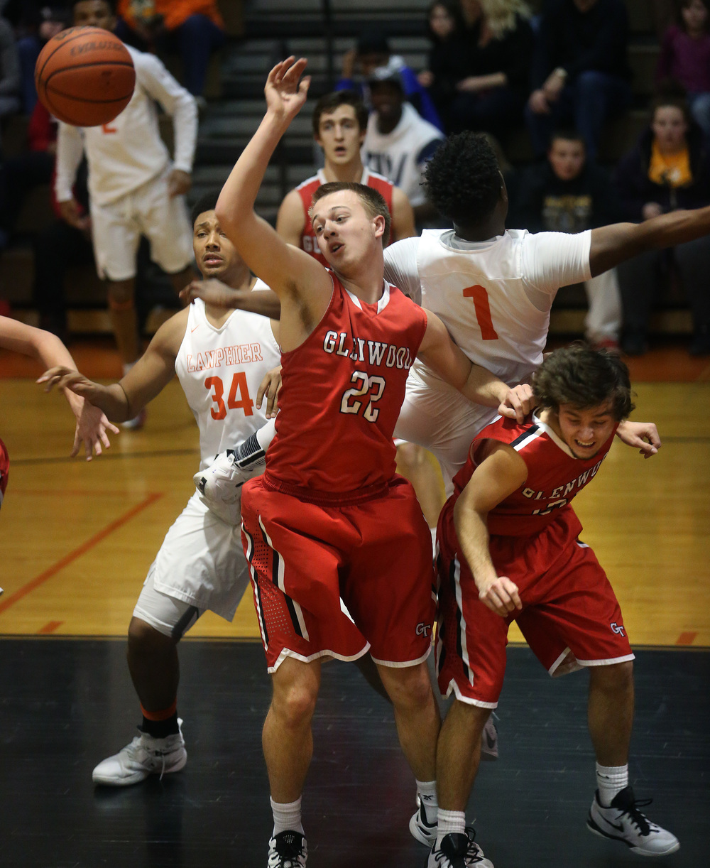 Glenwood's Parker Allen tries for a rebound under Lanphier's net during the first half. David Spencer/The State Journal Register