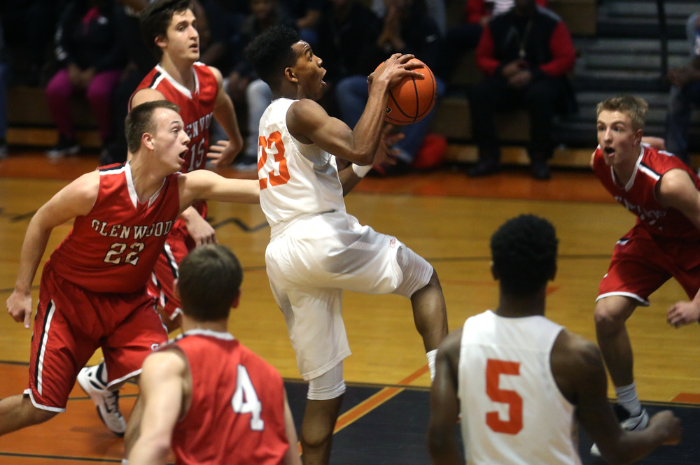Lanphier's Aundrae Williams tries to put up two points with Glenwood's Parker Allen defending at left. David Spencer/The State Journal Register