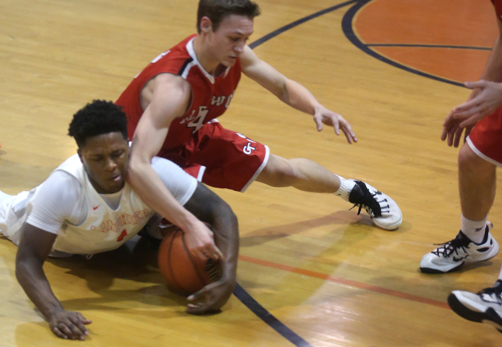 Lanphier's Yaakema Rose hits the deck for a loose ball while Glenwood defender Matt Bahlmann joins him in the scramble. David Spencer/The State Journal Register