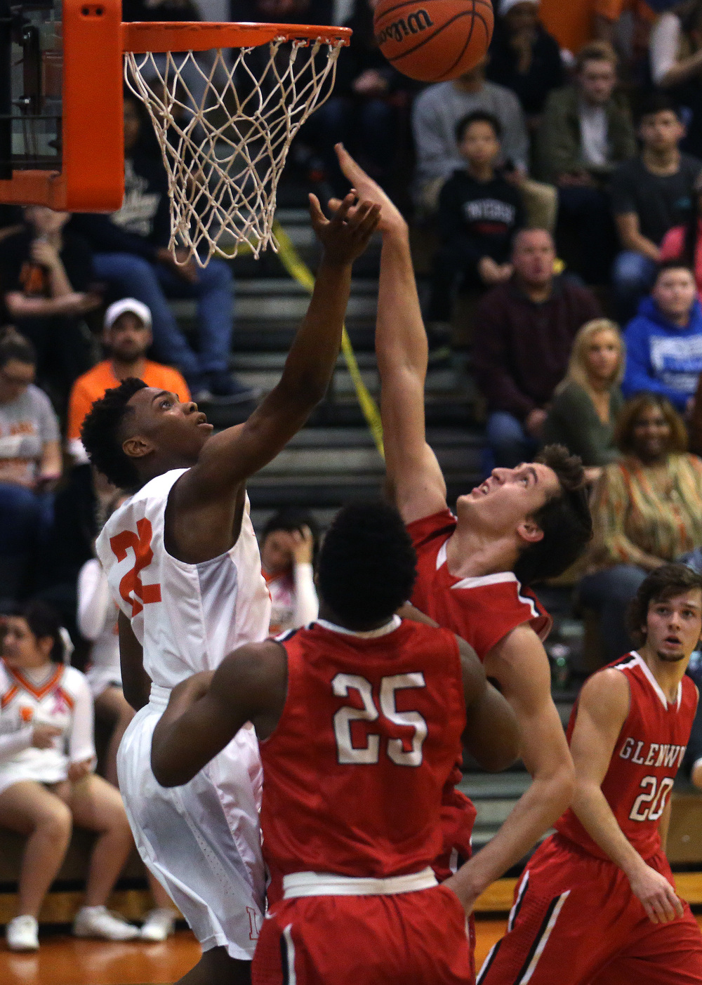 Glenwood's Joel Alexander puts up a shot blocked by Lanphier's Rudy Ester. David Spencer/The State Journal Register
