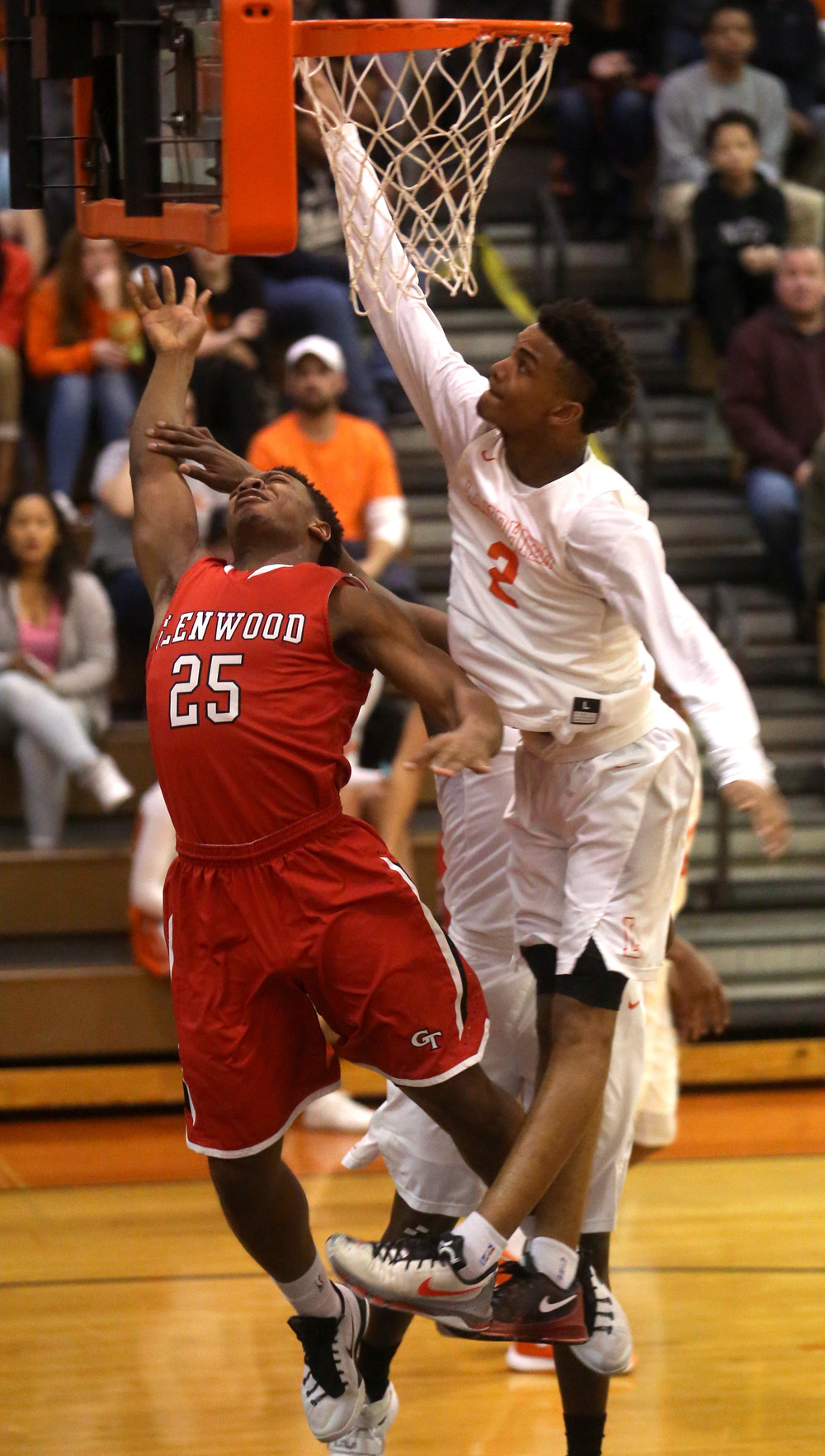 Glenwood's Clark Gaden has his shot blocked by defending Lanphier player Cardell McGee. David Spencer/The State Journal Register