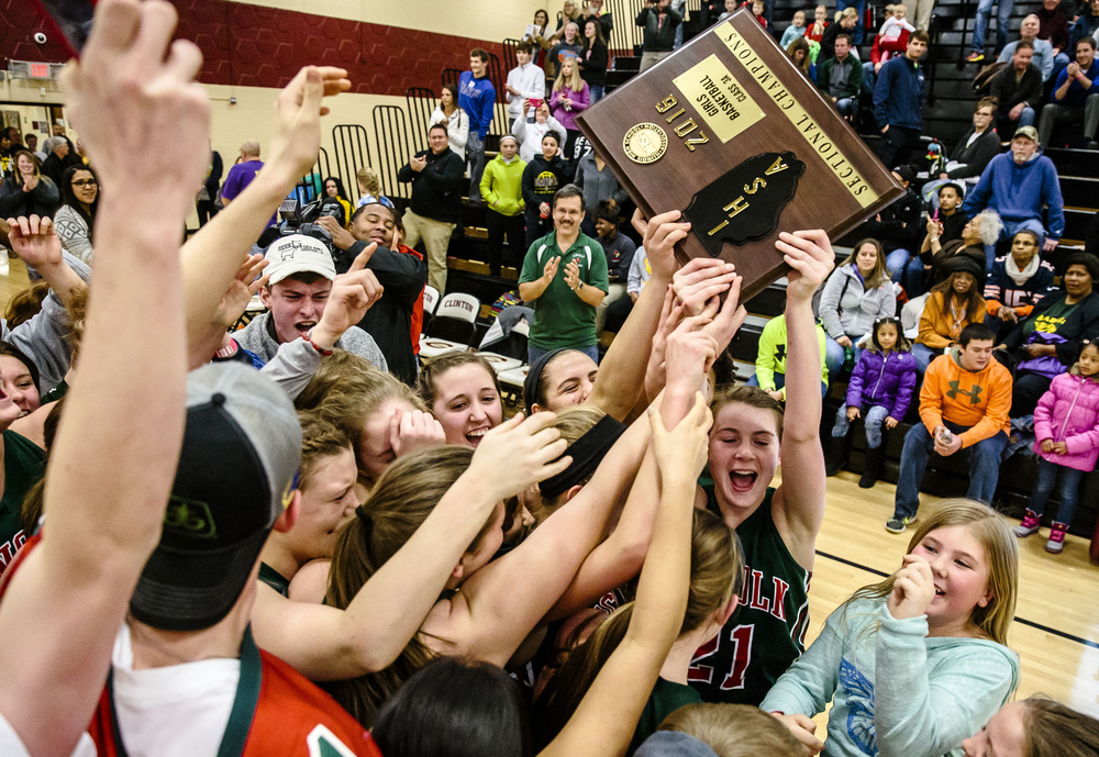 Lincoln's Hannah Cameron (21) and the Railsplitters are mobbed by the student section after they defeated Champaign St. Thomas More 53-39 in the Class 3A Clinton Sectional championship game at Clinton High School, Thursday, Feb. 25, 2016, in Clinton, Ill. Justin L. Fowler/The State Journal-Register