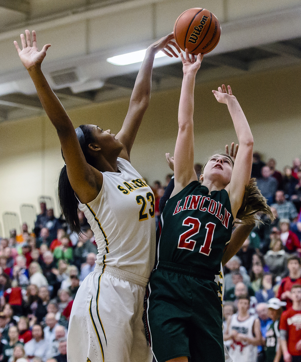Champaign St. Thomas More's Tori McCoy (23) blocks a shot from Lincoln's Hannah Cameron (21) in the third quarter during the Class 3A Clinton Sectional championship game at Clinton High School, Thursday, Feb. 25, 2016, in Clinton, Ill. Justin L. Fowler/The State Journal-Register