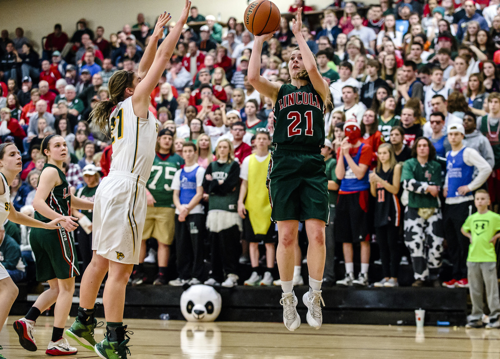 Lincoln's Hannah Cameron (21) shoots a jumper over Champaign St. Thomas More's Tatum McCall (21) in the third quarter during the Class 3A Clinton Sectional championship game at Clinton High School, Thursday, Feb. 25, 2016, in Clinton, Ill. Justin L. Fowler/The State Journal-Register