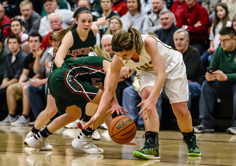 Lincoln's Kaelyn Froebe (5) tries to steal the ball away from Champaign St. Thomas More's Tatum McCall (21) in the fourth quarter during the Class 3A Clinton Sectional championship game at Clinton High School, Thursday, Feb. 25, 2016, in Clinton, Ill. Justin L. Fowler/The State Journal-Register