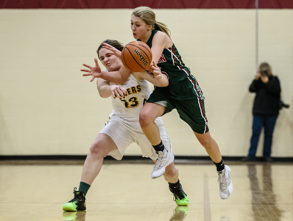 Lincoln's Kaelyn Froebe (5) is fouled by Champaign St. Thomas More's Andie Bolton (13) as she goes for a steal in the fourth quarter during the Class 3A Clinton Sectional championship game at Clinton High School, Thursday, Feb. 25, 2016, in Clinton, Ill. Justin L. Fowler/The State Journal-Register