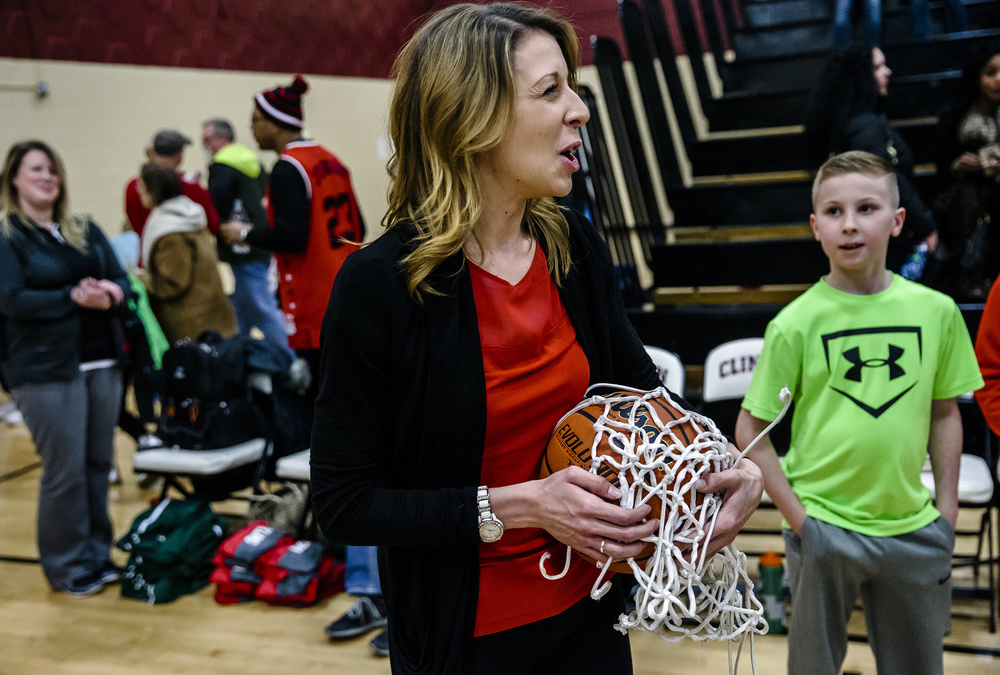Lincoln girls basketball head coach Taylor Richmond celebrates with the game ball and the nets after the Railsplitters defeated Champaign St. Thomas More 53-39 in the Class 3A Clinton Sectional championship game at Clinton High School, Thursday, Feb. 25, 2016, in Clinton, Ill. Justin L. Fowler/The State Journal-Register