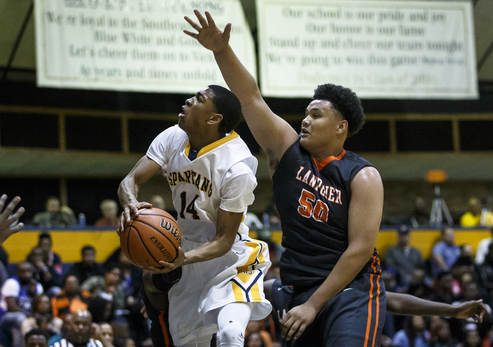 Southeast's Trevyon Williams (14) goes up for a shot against Lanphier's William Boles (50) in the first half at Herb Scheffler Gymnasium, Friday, Feb. 26, 2016, in Springfield, Ill. Williams led the Spartans with 24 points. Justin L. Fowler/The State Journal-Register