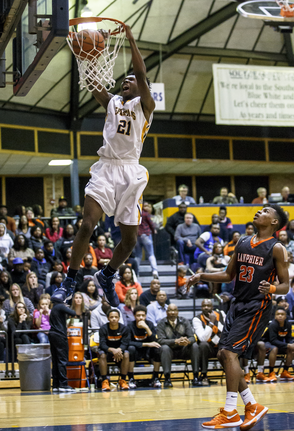 Southeast's Anthony Fairlee (21) goes up for a dunk against Lanpheir's Aundrae Williams (23) in the first half at Herb Scheffler Gymnasium, Friday, Feb. 26, 2016, in Springfield, Ill. Justin L. Fowler/The State Journal-Register