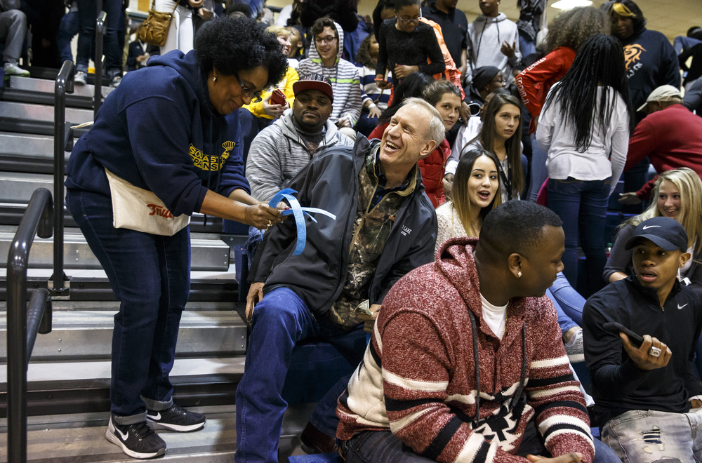 Illinois Gov. Bruce Rauner buys a 50/50 ticket from Diana Seawood during the Lanphier vs. Southeast game at Herb Scheffler Gymnasium, Friday, Feb. 26, 2016, in Springfield, Ill. Justin L. Fowler/The State Journal-Register