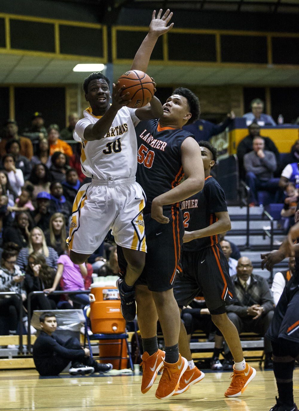 Southeast's D'Angelo Hughes (30) goes up for a shot against Lanphier's William Boles (50) in the first half at Herb Scheffler Gymnasium, Friday, Feb. 26, 2016, in Springfield, Ill. Justin L. Fowler/The State Journal-Register
