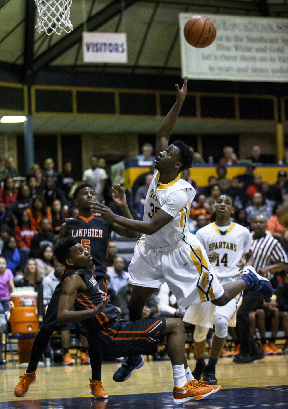 Southeast's D'Angelo Hughes (30) lets a floater go against Lanphier's Aundrae Williams (23) in the first half at Herb Scheffler Gymnasium, Friday, Feb. 26, 2016, in Springfield, Ill. Justin L. Fowler/The State Journal-Register