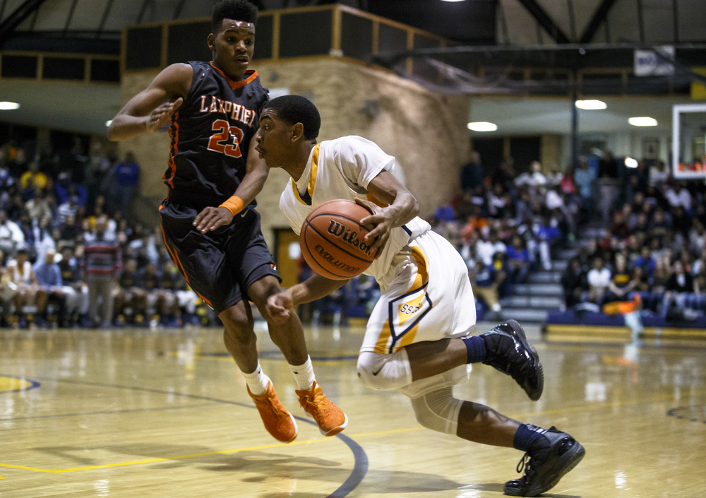Southeast's Trevyon Williams (14) drives towards the basket against Lanphier's Aundrae Williams (23) in the first half at Herb Scheffler Gymnasium, Friday, Feb. 26, 2016, in Springfield, Ill. Justin L. Fowler/The State Journal-Register