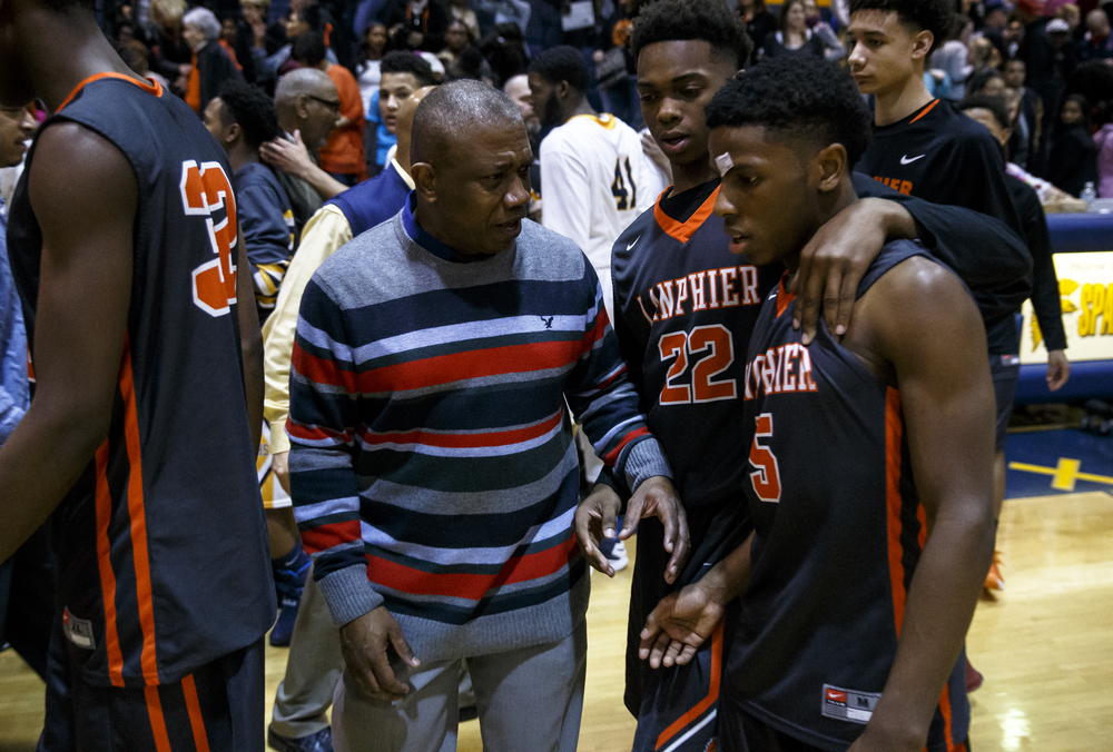Southeast head basketball coach Lawrence Thomas comes over to talk with Lanphier's Xavier Bishop (5) after the Spartans defeated the Lions at Herb Scheffler Gymnasium, Friday, Feb. 26, 2016, in Springfield, Ill. Justin L. Fowler/The State Journal-Register