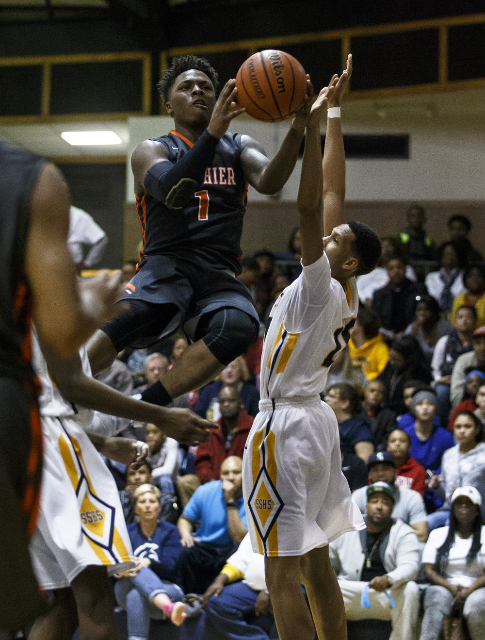 Lanphier's Yaakema Rose (1) goes up to the basket against Southeast's Isaiah Walton (10) in the second half at Herb Scheffler Gymnasium, Friday, Feb. 26, 2016, in Springfield, Ill. Justin L. Fowler/The State Journal-Register