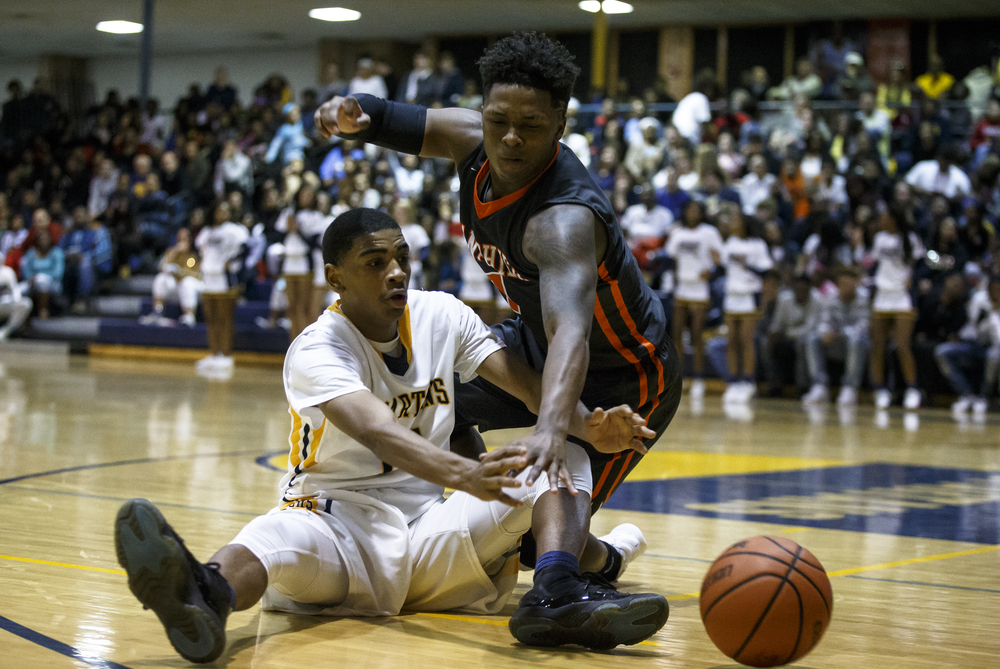 Lanphier's Yaakema Rose (1) tries to steal the ball away from Southeast's Trevyon Williams (14) in the second half at Herb Scheffler Gymnasium, Friday, Feb. 26, 2016, in Springfield, Ill. Justin L. Fowler/The State Journal-Register