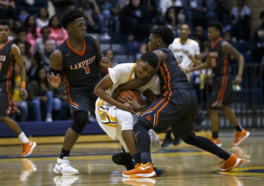 Southeast's Trevyon Williams (14) gets tangled up with Lanphier's Xavier Bishop (5) as the Lions try to force a turnover in the second half at Herb Scheffler Gymnasium, Friday, Feb. 26, 2016, in Springfield, Ill. Justin L. Fowler/The State Journal-Register