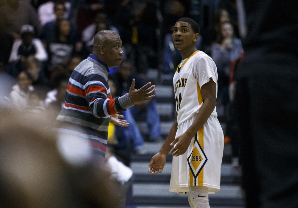 Southeast head basketball coach Lawrence Thomas talks with Southeast's Trevyon Williams (14) during a break in play as the Spartans take on Lanphier in the second half at Herb Scheffler Gymnasium, Friday, Feb. 26, 2016, in Springfield, Ill. Justin L. Fowler/The State Journal-Register
