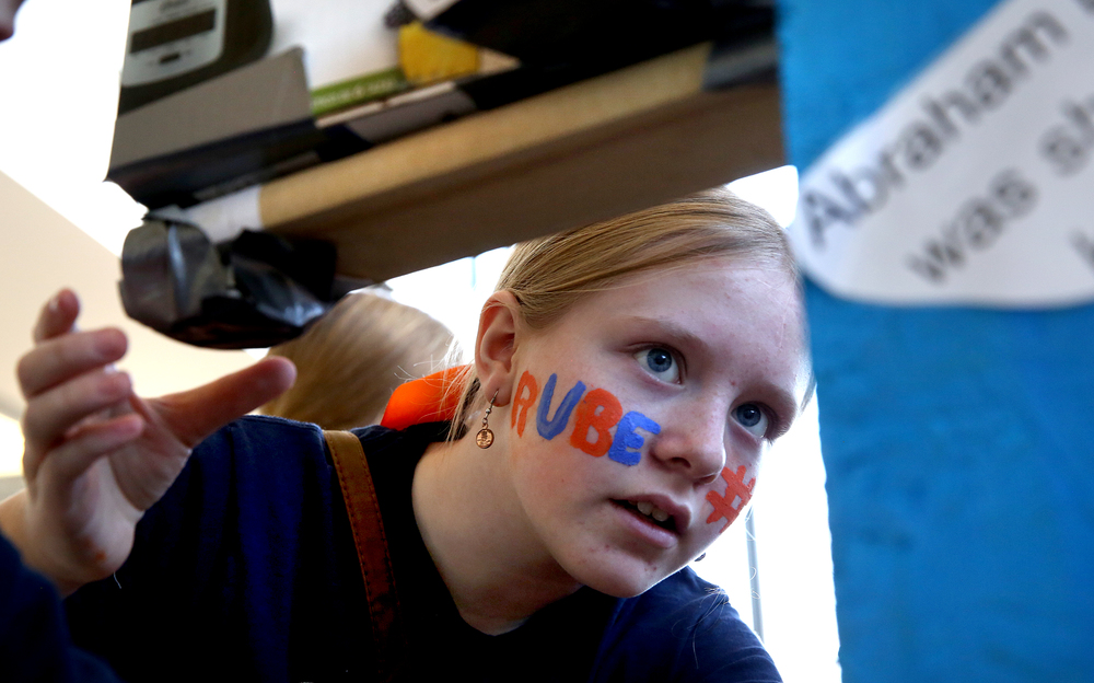 RUBE #1, drawn with face-paint, graced the face of fifth-grade Rochester Intermediate student Hayley Covert who sets into motion part of her school team's Abraham Lincoln-themed Rube Golberg machine on a practice run Saturday morning. David Spencer/The State Journal Register