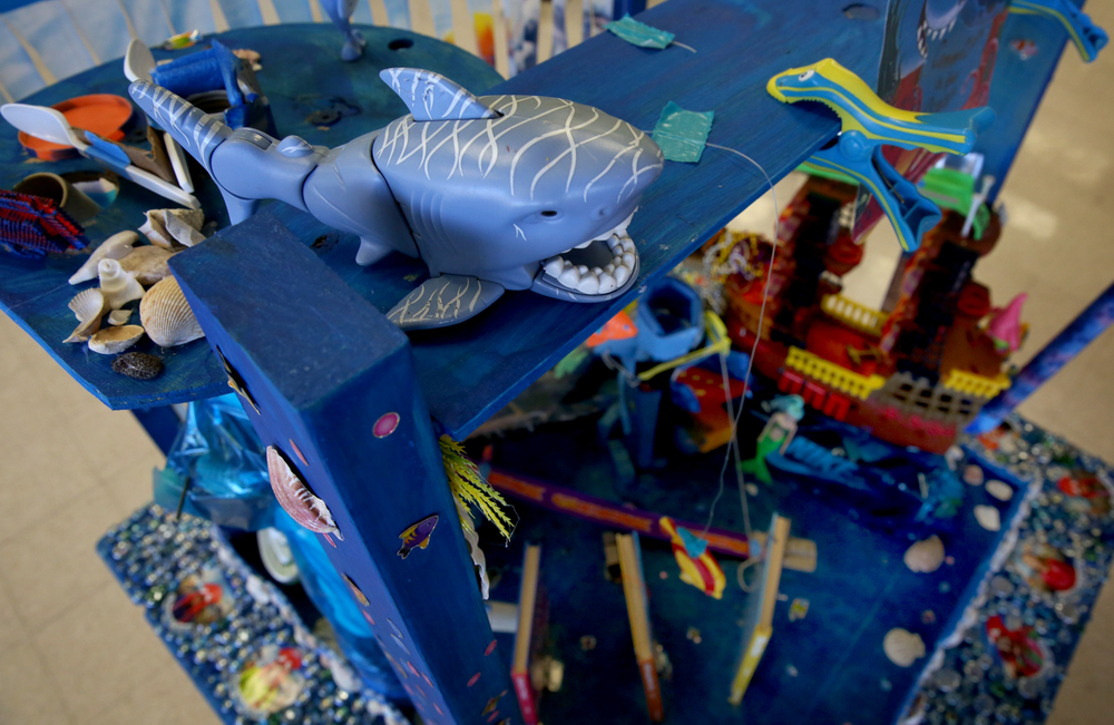 A menacing toy shark ruled over Commotion in the Ocean, a nautical-themed Rube Goldberg machine built by a team of fifth grade students from Springfield Christian School, on display in the Student Union at LLCC Saturday. David Spencer/The State Journal Register