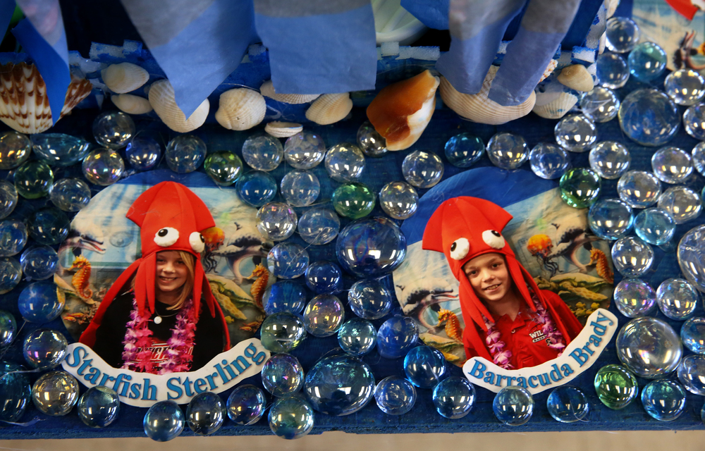 Commotion in the Ocean, a nautical-themed Rube Goldberg machine built by a team of fifth grade students from Springfield Christian School, featured individual photographs of student team members outfitted in their finest squid fashions incorporated into the machine itself. It was on display in the Student Union at LLCC Saturday. David Spencer/The State Journal Register