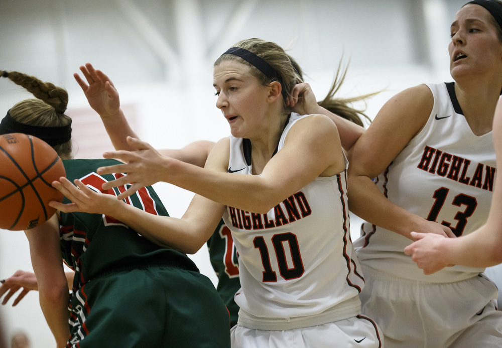 Highland's Caitlin Lammers (10) goes for a rebound against Lincoln's Hailie Williams (10) in the first quarter during the Class 3A UIS Supersectional at The Recreation and Athletic Center on the UIS campus, Monday, Feb. 29, 2016, in Springfield, Ill. Justin L. Fowler/The State Journal-Register