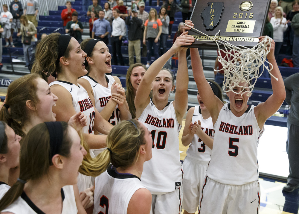 Highland's Amanda Ponce (5) and Caitlin Lammers (10) hoist up the trophy after Highland defeated Lincoln 48-40 in the Class 3A UIS Supersectional at The Recreation and Athletic Center on the UIS campus, Monday, Feb. 29, 2016, in Springfield, Ill. Justin L. Fowler/The State Journal-Register