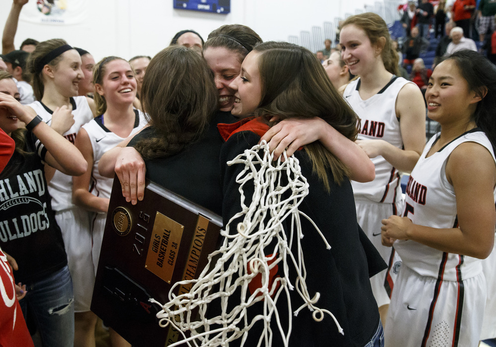 Highland's Amanda Ponce (5) is swarmed after Highland takes the trophy for defeating Lincoln 48-40 in the Class 3A UIS Supersectional at The Recreation and Athletic Center on the UIS campus, Monday, Feb. 29, 2016, in Springfield, Ill. Justin L. Fowler/The State Journal-Register