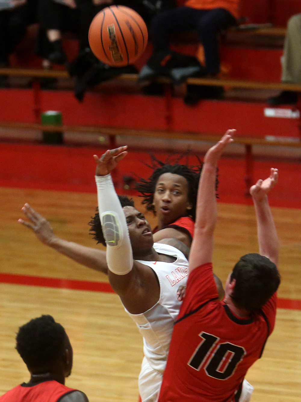 Lanphier's Yaakema Rose at center defends while Springfield player Trevor Minder tries to get the ball past him. David Spencer/The State Journal Register