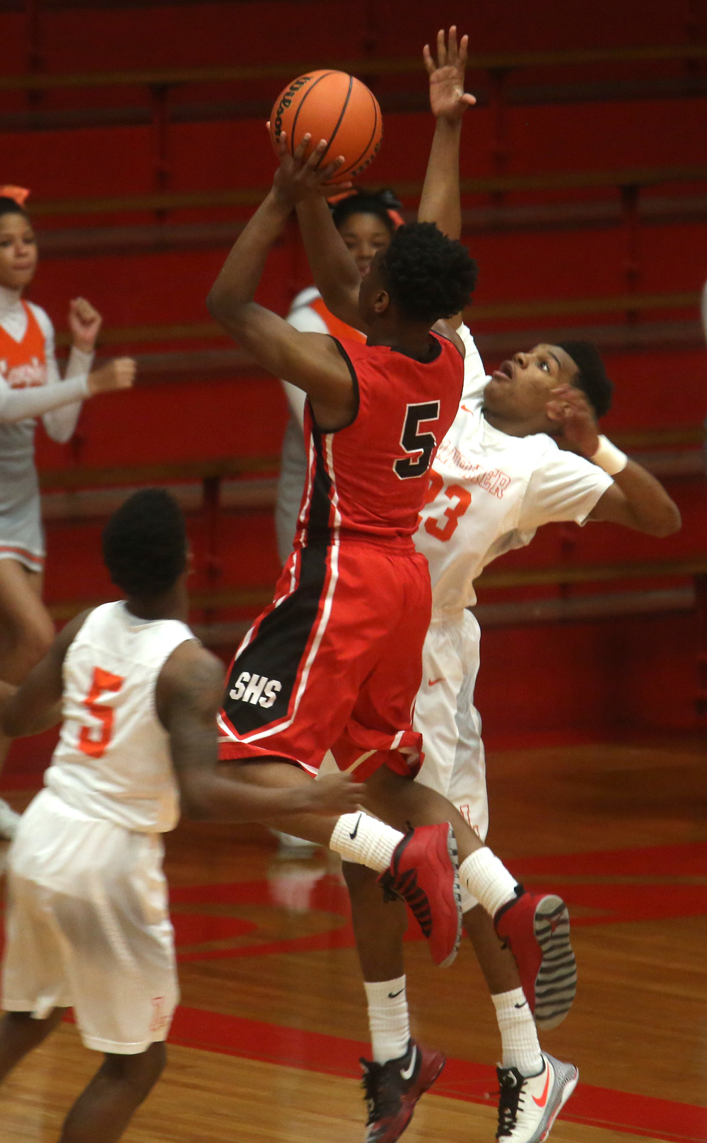 Springfield player Isaac Nelson puts up a shot while being defended by Lanphier's Aundrae Williams in the first half. David Spencer/The State Journal Register