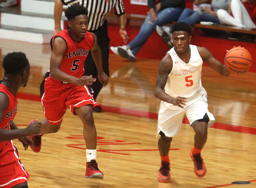 Lanphier player Xavier Bishop is pursued by Springfield's Isaac Nelson. David Spencer/The State Journal Register