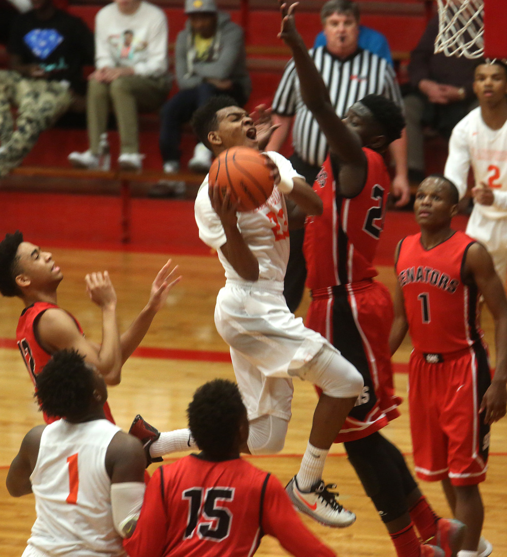 Driving Lanphier player Aundrae Williams goes airborne while putting up a shot late in the first half. David Spencer/The State Journal Register