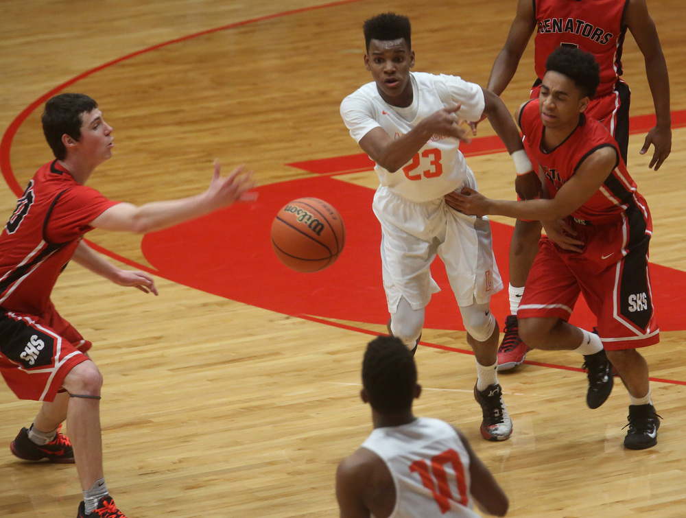 Lanphier's Aundrae Williams (23) passes to teammate Jayden Collins. (10) David Spencer/The State Journal Register