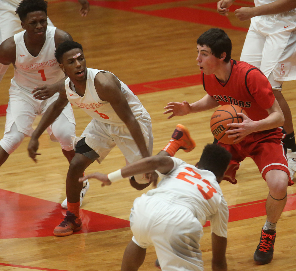 Springfield player Trevor Minder looks to get past a gauntlet of Lanphier defenders including Isaac Bishop at left and Aundrae Williams at right. David Spencer/The State Journal Register